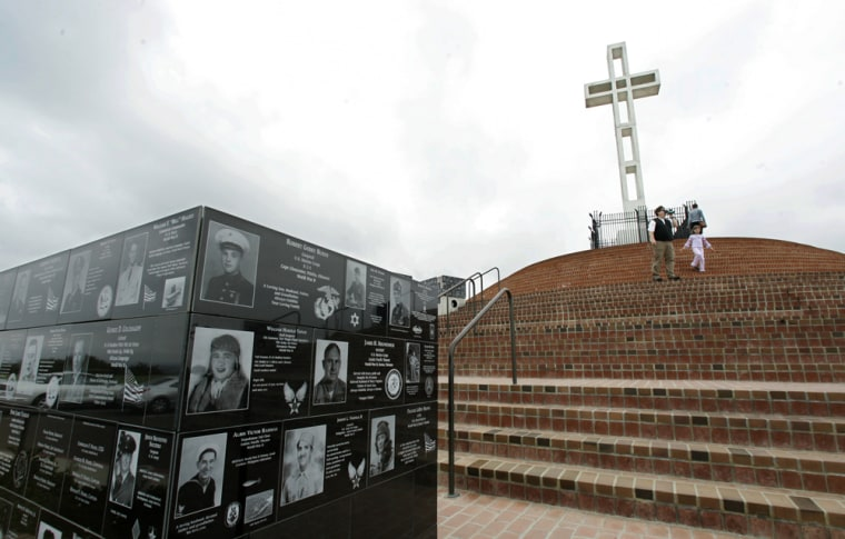Plaques honoring war veterans adorn the walls around the 29-foot Mount Soledad Cross at the Mount Soledad Veterans Memorial on Wednesday in San Diego.
