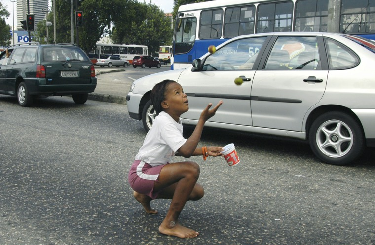 Marcela da Silva, 9, juggles limes for tips in Rio de Janeiro, Brazil, on Thursday. The number of children working around the world is declining for the first time, the International Labor Organization reports.