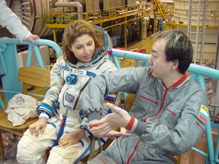 Iranian-born businesswoman Anousheh Ansari sits alongside Japanese entrepreneur Daisuke Enomoto during cosmonaut training in 2006. Ansari replaced Enomoto on a flight to the international space station, and now Enomoto is suing to get a refund.