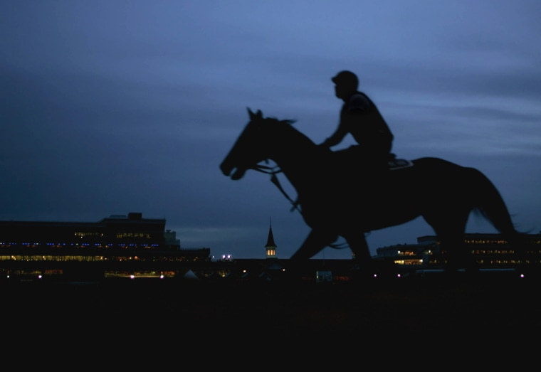A horse and rider take to the the track during an early morning workout at Churchill Downs onin Louisville, Ky.