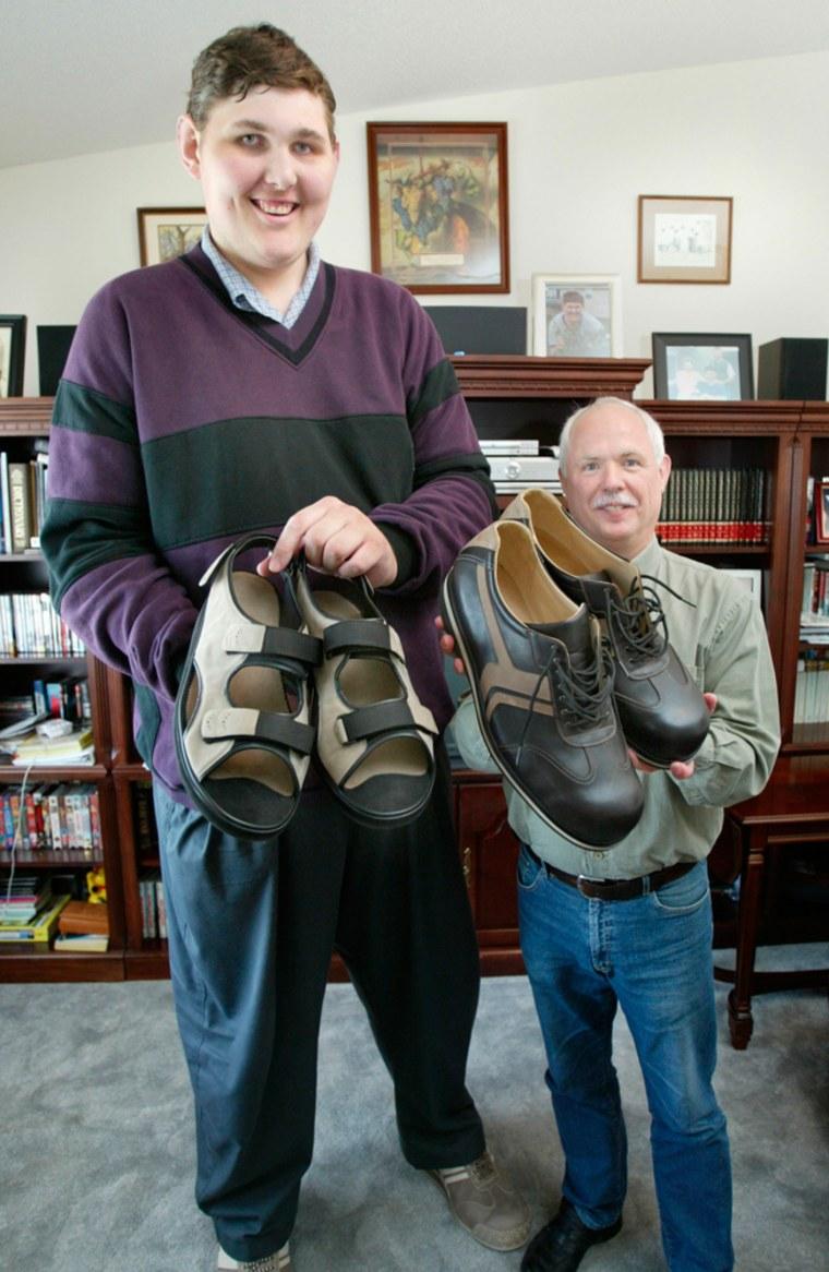 Igor Vovkovinskiy, left, of Rochester, Minn., and German shoemaker Georg Wessels show off the size 26 shoes Wessels made for Vovkovinskiy on Wednesday in Rochester.