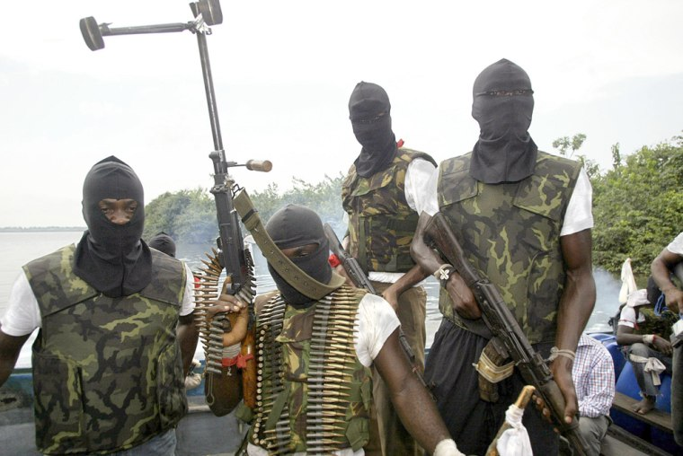 Members of a militant group called Movement for the Emancipation for the Niger Delta (MEND) patrol the Niger Delta area of Nigeria on Feb. 24. Most of the crude in Niger, Africa's largest oil producer, is pumped from beneath this region.