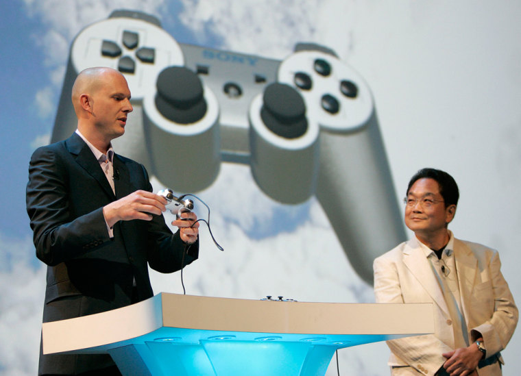 Phil Harrison, president of Sony Computer Entertainment's Worldwide Studios, demonstrates the new motion-sensitive PlayStation 3 game controller while Ken Kutaragi, presidentof Sony Computer Entertainment, looks on in this handout photo from a Monday news conference in Culver City, Calif.