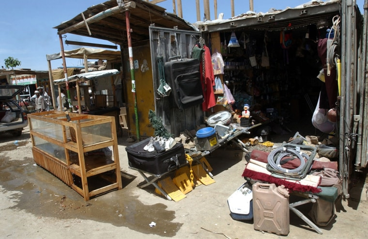 Secondhand materials are displayed for sale on Monday in front of a shop outside the U.S. military base in Bagram, north of Kabul, Afghanistan. Computer storage devices stolen from the U.S. base and once widely available in shops are now scarce items.