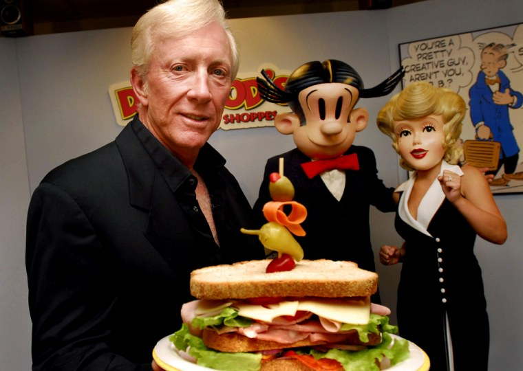 Dean Young shows off a Dagwood sandwich at his New Orleans test kitchen Tuesday. Young, 66, who inherited the job of drawing the Blondie comic strip, from his father plans to open a chain of 'Dagwood's Sandwich Shoppes.'