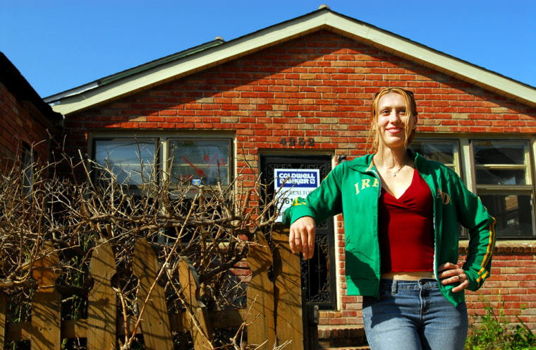 Autumn Nurton, 24, stands in front of a flooded house late last month in New Orleans that she hopes to buy at a great price. Although vast swaths of this hurricane-battered city are still without electricity and basic services, residential real estate sales are at a fever pitch, a shining spot in an otherwise struggling economy.
