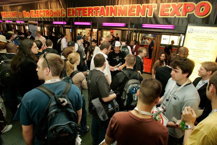 Show-goers wait for the floor to open Wednesday at the Electronic Entertainment in the Los Angeles Convention Center. This year, the hot topic at E3 isn't a new video game, but a price tag.
