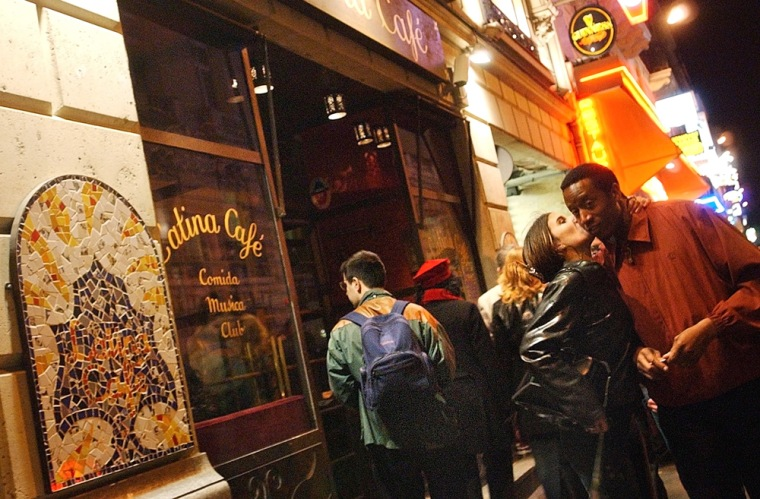 People walk past the Latina Cafe, near the Champs Elysees in Paris. Paris is the home of some of the best nightlife and evening activities on the planet, including great sites for vibrant teenagers looking for nights to remember.
