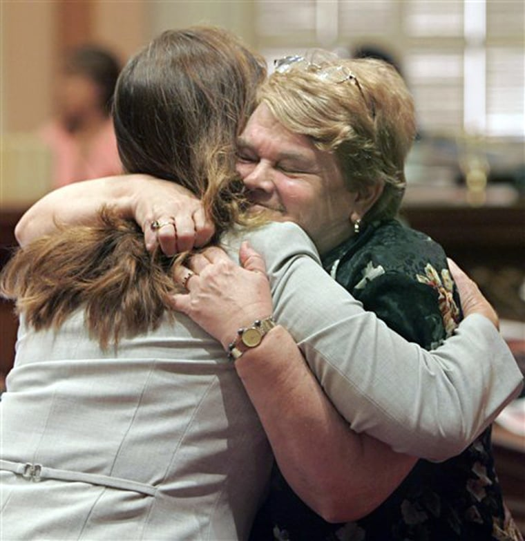 California Sen. Sheila Kuehl, right, embraces Sen. Gloria Romeroafter the state Senate passed Kuehl's bill requiring California's textbooks to include sexual orientation of individuals when citing their contributions to history.