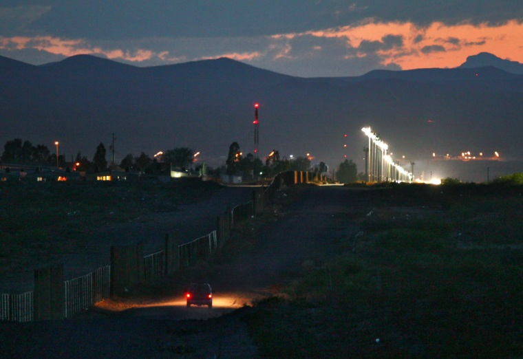 A U.S. border patrol agent drives along the U.S. side of the American-Mexican border, near Douglas, Ariz.,on April 27.