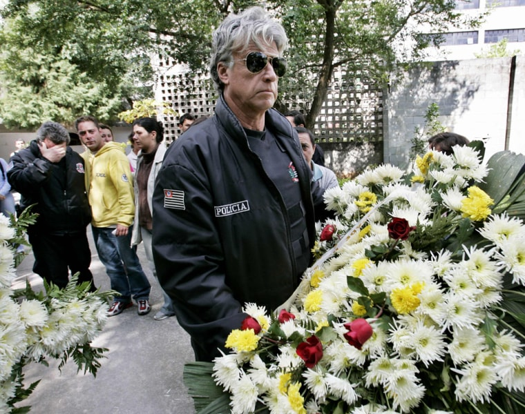Relatives and colleagues of Brazilian policeman killed in wave of attacks mourn his death