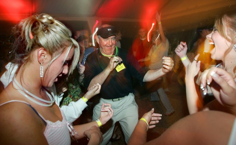 Georgia Gov. Sonny Perdue, center, dances Sunday with students including Christie Siciliano, 17, left, and Emily Melo, 16, right, during an after-prom party for students of Brookwood High School, at the governor's mansion in Atlanta.