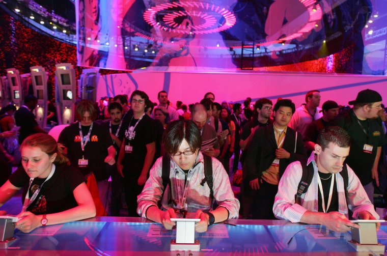 Visitors play electronic games on Sony's