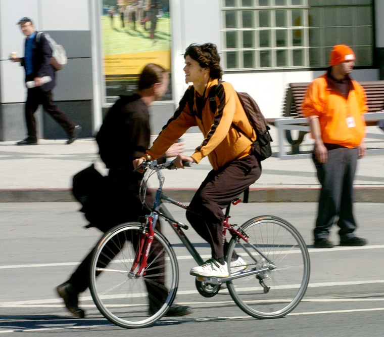 A bicyclist rides through downtown San Francisco. The Bay Area has about 36,000 commuters who pedal to work each day.