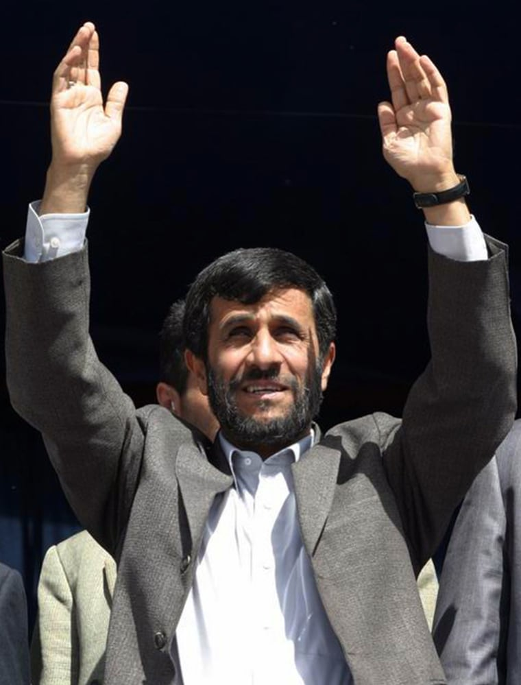 Iranian President Ahmadinejad greets the people of Arak in Iran
