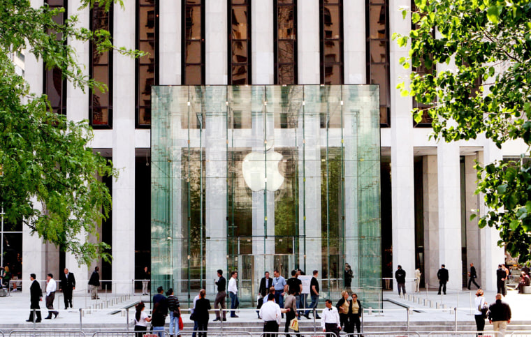 People gather around the glass entrance to the new Apple store on New York's fashionable Fifth Avenue on May 18. This is the California computer company's second New York retail store.