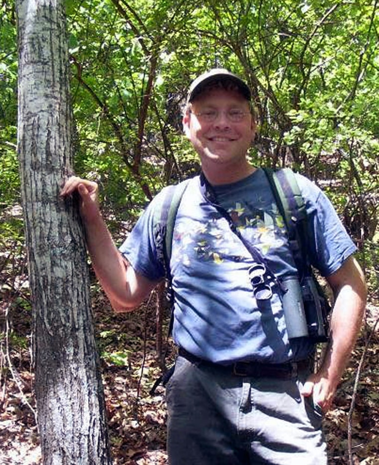 Nathan Klaus, a senior wildlife biologist with the Georgia Department of Natural Resources, stands beside a rare American chestnut tree he spotted in the F.D. Roosevelt State Park near Warm Springs, Ga.