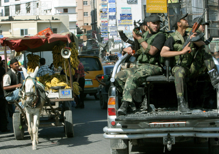 Militants comprising part of a new security force of the Hamas-led Palestinian government patrol the main square in Gaza City on Wednesday