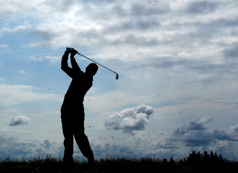 Spain's Sergio Garcia is silhouetted as he plays a shot on the opening day of the British Open golf championship at Royal Troon golf course in Troon, Scotland Thursday July 15, 2004.