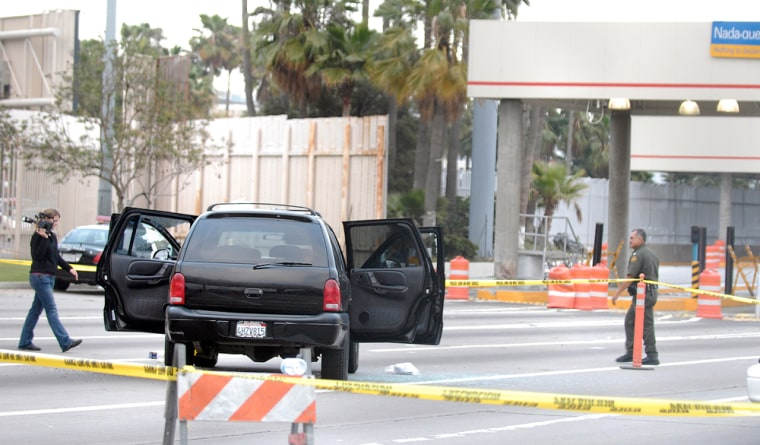 The driver of this SUV was shot dead after he tried to run the border crossing near San Diego. The car is seen Thursday parked just before the border gates to Tijuana, Mexico.