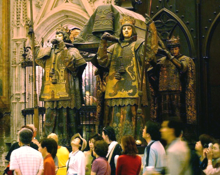 Tourists walk by the tomb of Spanish explorer Christopher Columbus in the Cathedral of Seville, Spain. Spanish researchers recently determined that Columbus' remains are indeed buried in the tomb, based on DNA results. Another Columbustomb is located in the Dominican Republic, butDNA tests have not been conducted on the remains buried there.