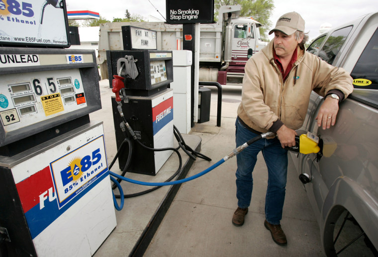 Steve Duenow fills his truck with a E85 fuelin St. Ansgar, Iowa. A corn and soybean farmer, Duenow sees the value in buying a flex- fuel truck that can burn regular gas, 10 percent ethanol or the newest renewable fuel,E85 --a blend of 85 percent grain alcohol distilled from corn and 15 percent gas.