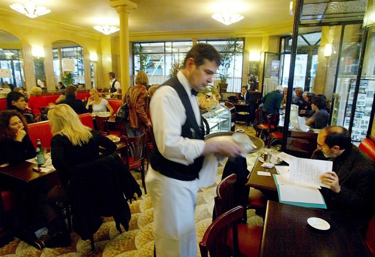 Business bustles at the Cafe de Flore in Paris.