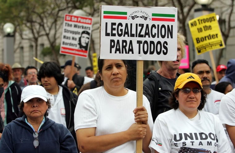 "Demonstrators attending a pro-immigration rally in San Francisco hold signs in Spanish, including one which reads ""Legal status for all.'' Linguists and historians say the current immigration debate and proposals to make English the official language of the U.S. resemble other linguistic struggles across the globe."