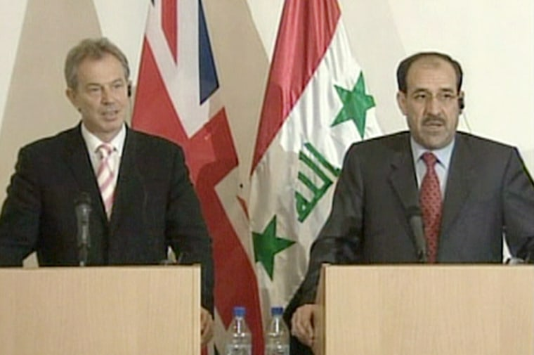 British Prime Minister Tony Blair meets with the new Iraqi Prime Minister, Nuri al-Maliki, during a surprise visit Monday to mark the formation of a new Iraqi government.
