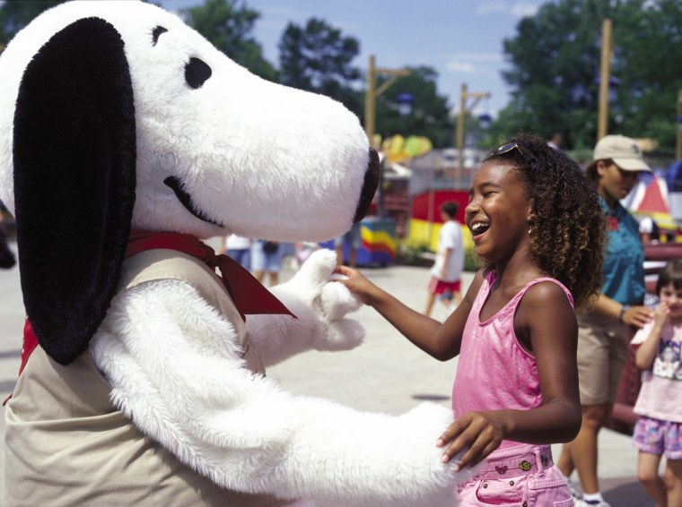 Snoopy greets a girl at Cedar Point amusement park's Camp Snoopy.
