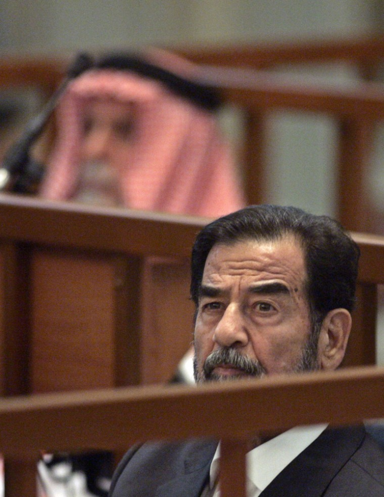Former Iraqi President Saddam Hussein attends his trial held in Baghdad's heavily fortified Green Zone