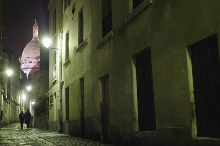 A couple walks along a street on Montmar