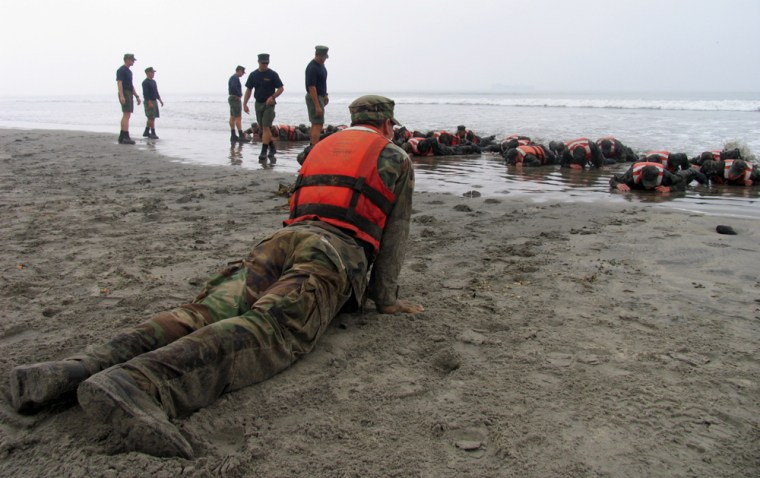 """U.S. Navy Sea, Air, Land (SEAL) recruits training on the beach at the Naval Special Warfare Center in Coronado, Californiaduring """"Hell Week."""""""