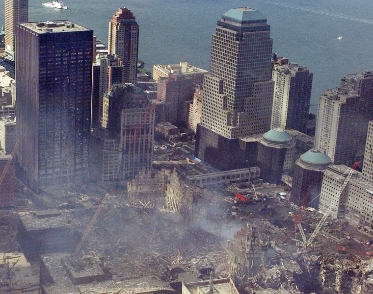 In this Sept. 26, 2001, photo, an aerial view shows the World Trade Center destruction in the aftermath of the Sept. 11, 2001, attacks in New York. The black tower, left, is the vacant 41-story former Deutsche Bank AG building, which remains contaminated with toxic waste and still holding tiny body parts more than four years after the trade center collapsed.