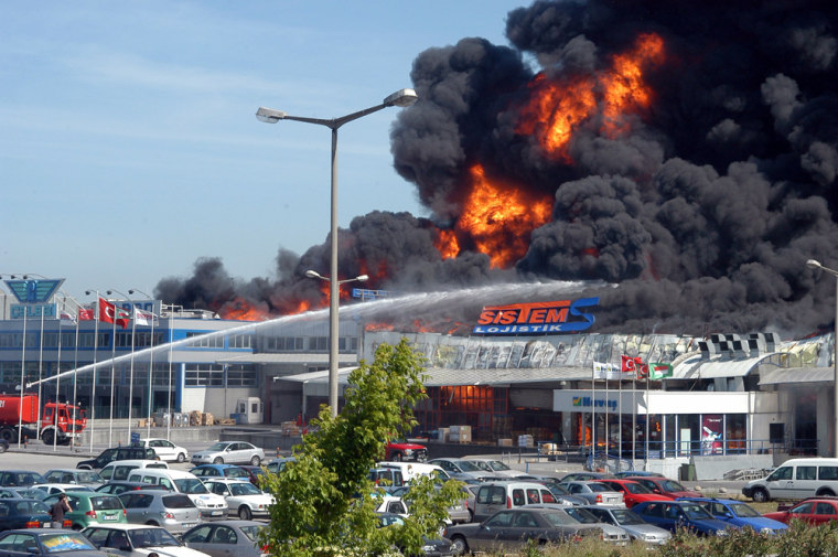 Firefighters hose down the fire at Ataturk Airport in Istanbul