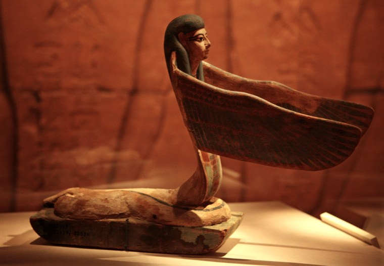 """A statuette of a winged serpent with a human head is part of the exhibit titled """"Tutankhamun and the Golden Age of the Pharaohs"""" in Chicago."""