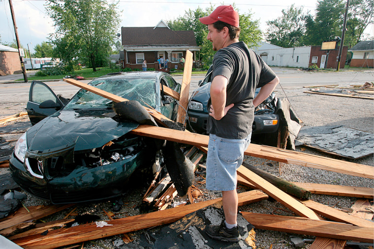 The severe weather in the Midwest included a possible tornado that damaged this car and other property in Otwell, Ind.