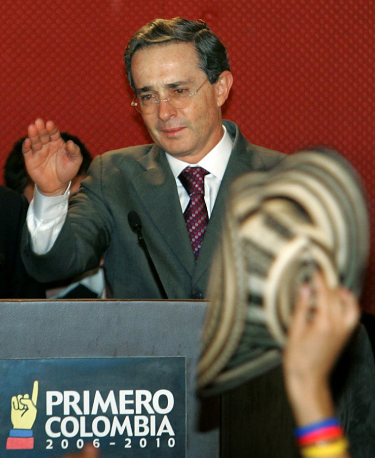 Colombian president Alvaro Uribe waves a