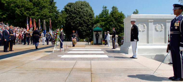 US President Bush stands after laying Memorial Day wreath at Tomb of the Unknowns near Washington