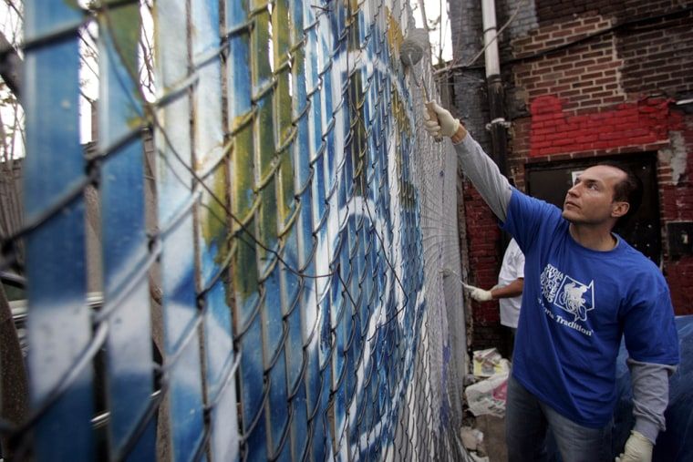 City Councilman Peter Vallone Jr., paints over graffiti in the Queens borough of New York on May 2. Since Vallone was elected in 2001, graffiti has become his signature issue.