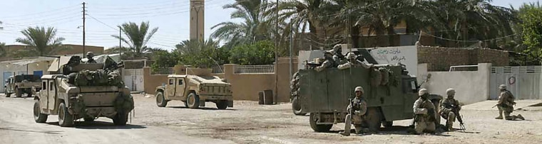 Marines from 3rd Platoon, Kilo Company, 3rd Battalion, 1st Marine Regiment, and soldiers of the Iraqi Security Forces patrol the streets of Haditha on Oct. 4 2005. The U.S. unit faces allegations that its members brazenly killed dozens of Iraqi civilians last November.