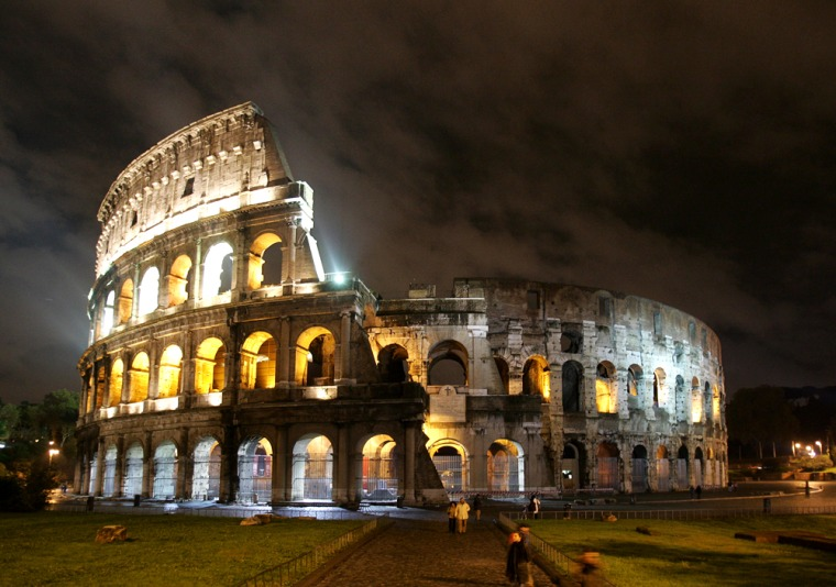 The ancient Colosseum is lit up.
