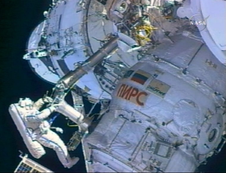 NASA astronaut Jeff Williams operates a boomon the international space station during Thursday's spacewalk.
