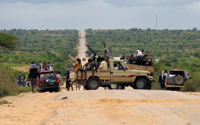 Members of Somali Islamic militia manage a road block in Bal'ad area in th outshirts of Mogadishu