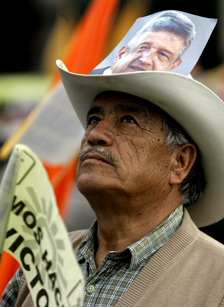 A supporter of Democratic Revolution Party (PRD) Andres Manuel Lopez Obrador stands Tuesday at Mexico City's main Zocalo plaza before the last presidential debate. Mexican elections are secheduled to take place on July 2.