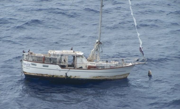In this photo provided by the U.S. Coast Guard, the Chaton De Foi floatsoffMilolii Bay, near Honolulu, on Monday.