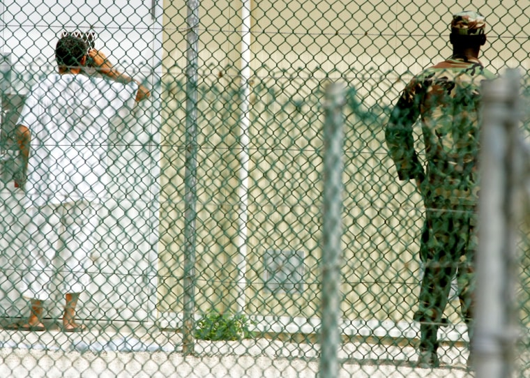 A detainee looks into the window of a cell at Camp 4 insidethe maximum security prison Camp Delta at Guantanamo Bay Naval Base onAug. 26, 2004, in Guantanamo Bay, Cuba.