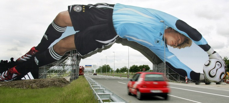 An advertising banner showing German national team goalkeeper Oliver Kahn overstretches a motorway near the Franz-Josef-Strauss Aiport in Munich, southern Germany. The opening match of the 2006 Soccer World Cup in Germany 2006 between Germany and Costa Rica will be played in Munich on Friday.