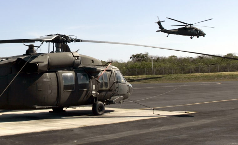 """A U.S. Army Black Hawk helicopter lifts off from the """"Hawk's Nest,"""" a U.S. anti-drug installation on Great Exuma Island in the central Bahamas on April 7. Defense Secretary Donald Rumsfeld has proposed ending Army helicopter support for a joint U.S.-Bahamas counter-drug program."""
