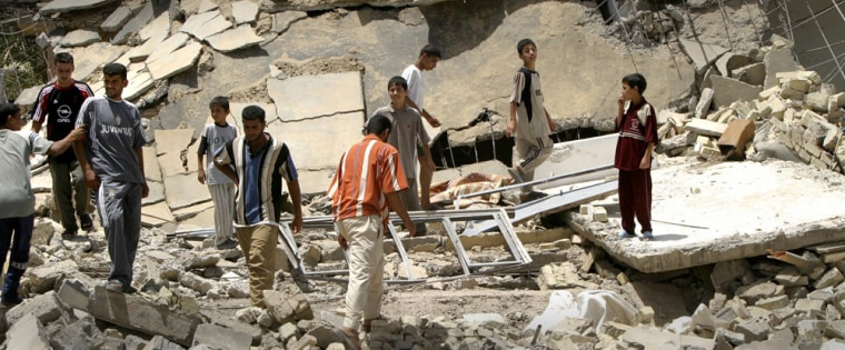 Iraqis sift through the rubble after a US raid in the town of Hibhib near Baquba